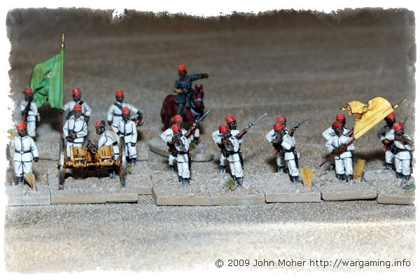 28mm Perry Egyptian Fellahin Infantry (from 4th Company by the Yellowy-Orange Flag) and supporting Artillery.