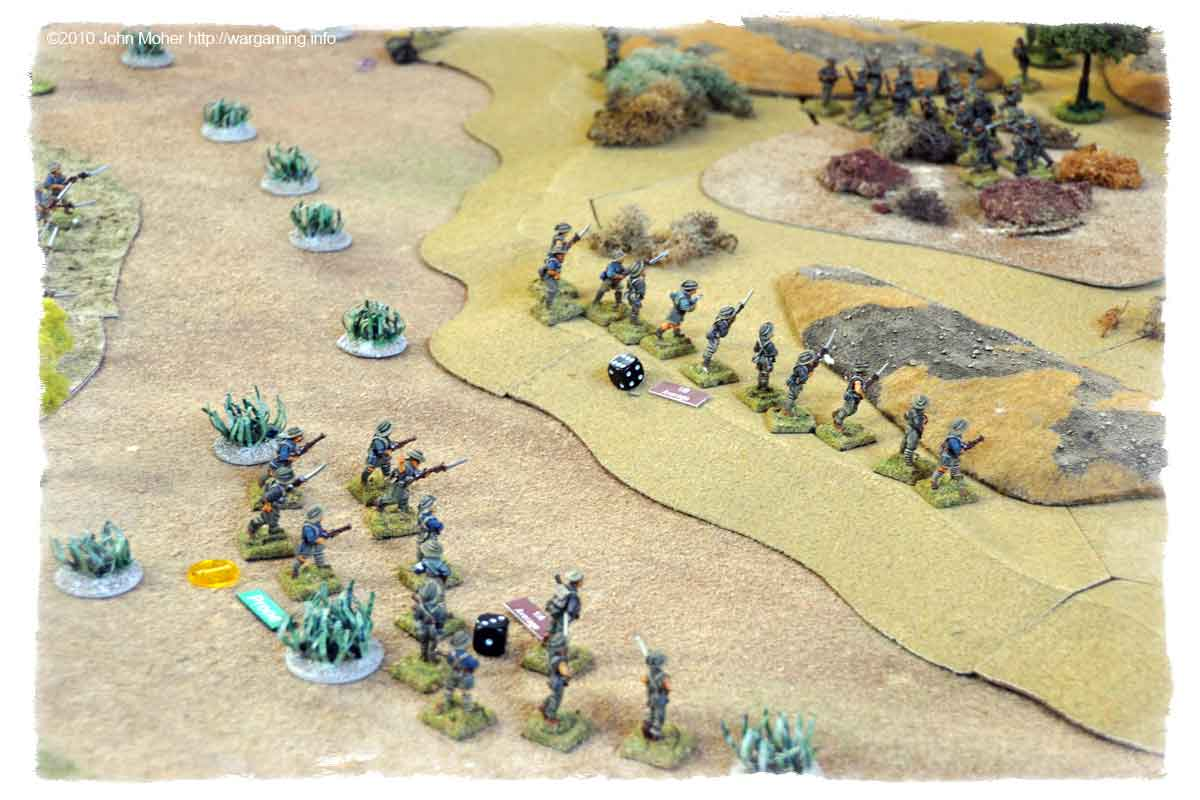 Reinforcements take over the assault and make it up the slope.