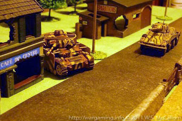 The Panzer IV skulks behind the Airfix bombed-out café!
