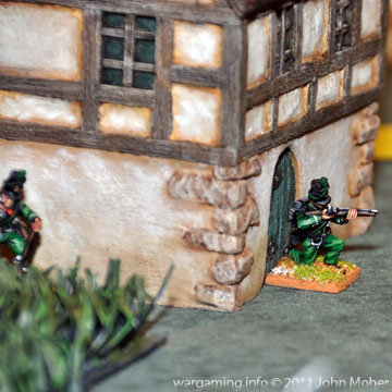 Chosen Man Patrick Harper moves into the Farmhouse Doorway under intermittent fire from the Poles.
