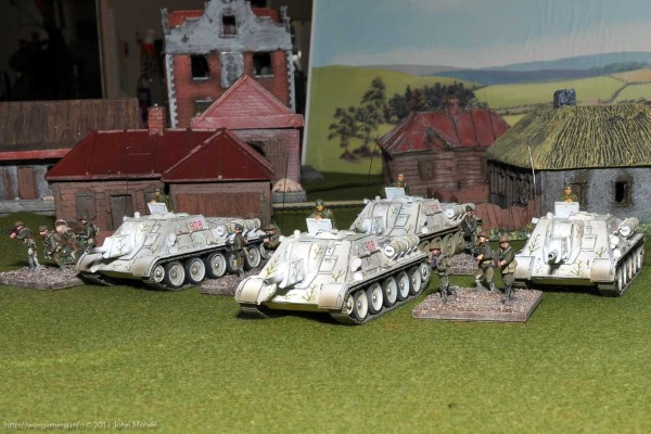 Forces of Valor SU-122's emerge from a town with Tank-Rider SMG Platoon escort...
