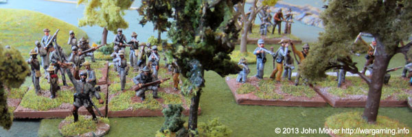 Confederates advance through the woodland towards the Cornfields.