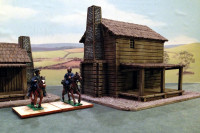 Warlord Games' North American Settler's Cabins