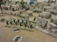 The Naval Brigade rapidly withdraws from the slums, at the sight of the Dervish Cavalry
