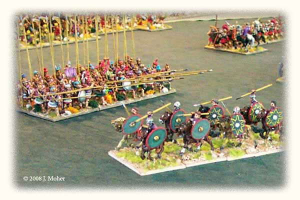 Anachronistic Ancient Battle: Late Imperial Roman Cavalry (350AD) ride past the opposing Macedonian Pikemen (320BC), supported by Early Imperial Roman Legionaries (100AD) at upper right.