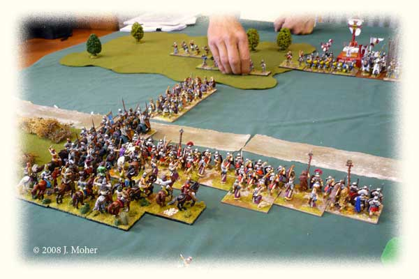 Pussy Footing Around - trying to get at the City Militia's flank without inciting the Swiss to action! A column of Auxilia heads into the woods, followed by the Armenian Cataphracts who hope to engage the Militia Spearmen frontally.