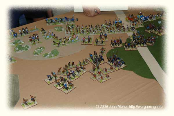 The Chionites & Light Infantry on the left have completed 2 bounds of feigned flight and the rest of the Kushan army is attacking in a disorganised mass towards the centre and right.