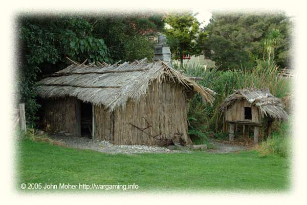 Replica of a local (as often Maori as European) Reed Cutter's Raupo as would be found amongst the European Settlements - like the Mail Runner's above it is fairly substantial including glass windows, a door and a fireplace, but like all Raupo's it has an earth floor and if badly sited could no doubt flood in heavy rain and such like.
