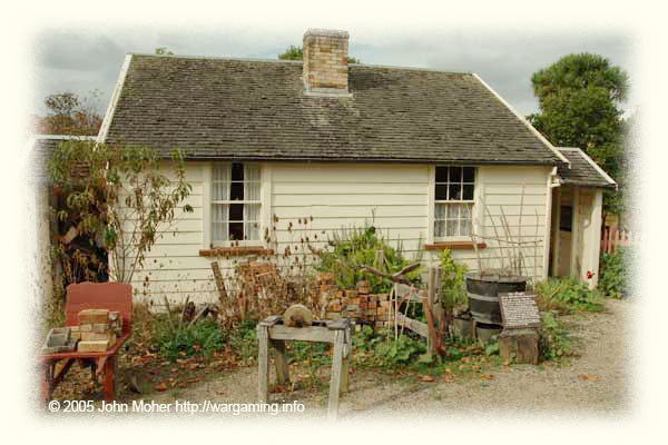 A typical Fencible Cottage looking it's best - in reality they may not have looked quite so 'spic & span' when originally built! The chimney marks the point where the dividing wall cuts it in half! This is much smaller than it looks in the photo!
