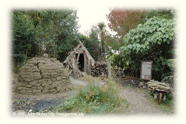 A typical Charcoal Burners Camp showing the kiln and the burner's temporary shelter - he'd need to stay here with the kiln for several days before being able to open it and unpack the burnt Titree into bags.