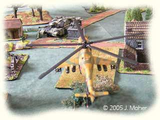 Mi-24 Hind D targets a Challenger MBT.