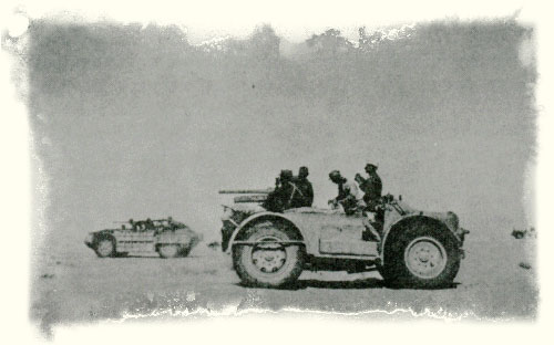 "This photo clearly shows three vehicles from the original ""Raggruppamento Sahariano AS"", the nearer is the SPA TL37 Camionetta AS mounting the 47/32 Anti-Tank Gun, the further vehicle is a Sahariana, probably 790 B, 792 B, or 798 B as it appears to mount a 20mm and a single MG, and finally in the right distance can be seen a second Sahariana."