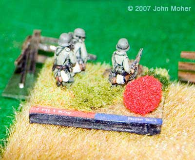 German Defenders, a Rifle Section from the 2nd Platoon of Kompanie 1. The red ball is a marker that denotes the stand has gone 'No Fire' through an unsuccessful reactive fire.