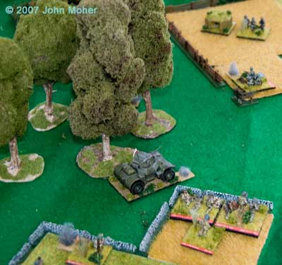 A Daimler Armoured Car and a Mortar FO move up to deal with the thickening German defence.