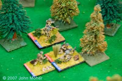 3 Platoon begin to move up through the centre of the wood.