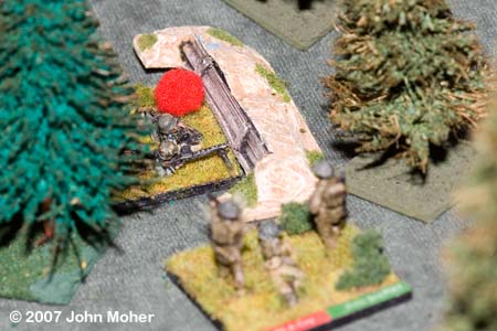 Elements of No.3 Platoon infiltrate a wooded German position.
