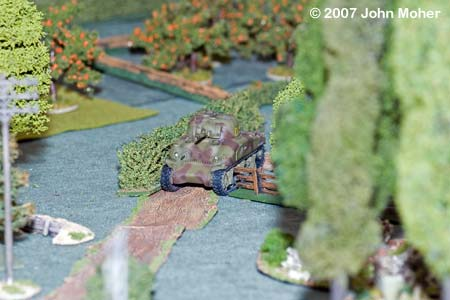 """She's a tight fit Guv"" - With part of the road clear the M4A1 Sherman squeezes down it to support No.1 Platoon's advance up the centre."